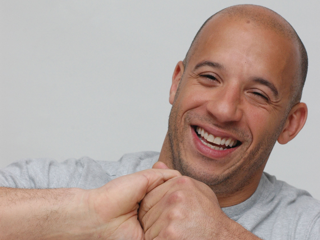 vin diesel Perhaps the first thing you notice about vin diesel is the bald head -- a great,  shiny expanse that seems to go on forever like much else about.